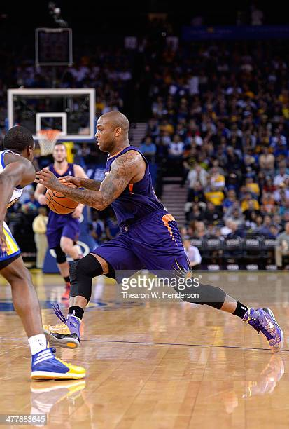 J Tucker of the Phoenix Suns dribbles the ball against the Golden State Warriors at ORACLE Arena on March 9 2014 in Oakland California NOTE TO USER...