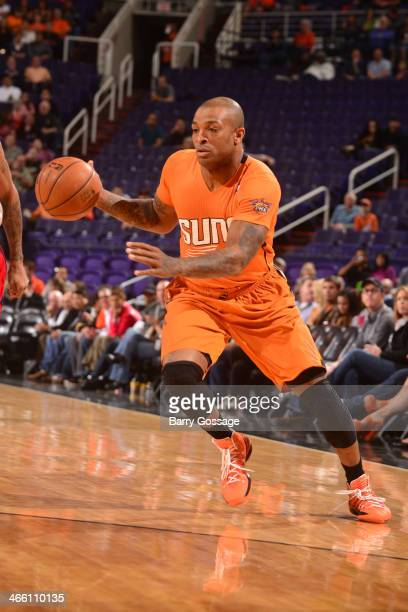 J Tucker of the Phoenix Suns dribbles the ball against the Washington Wizards on January 24 2014 at US Airways Center in Phoenix Arizona NOTE TO USER...