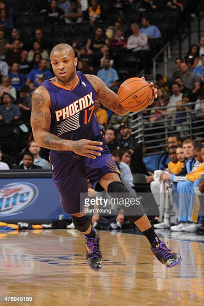 PJ Tucker of the Phoenix Suns drives against the Denver Nuggets on February 18 2014 at the Pepsi Center in Denver Colorado NOTE TO USER User...