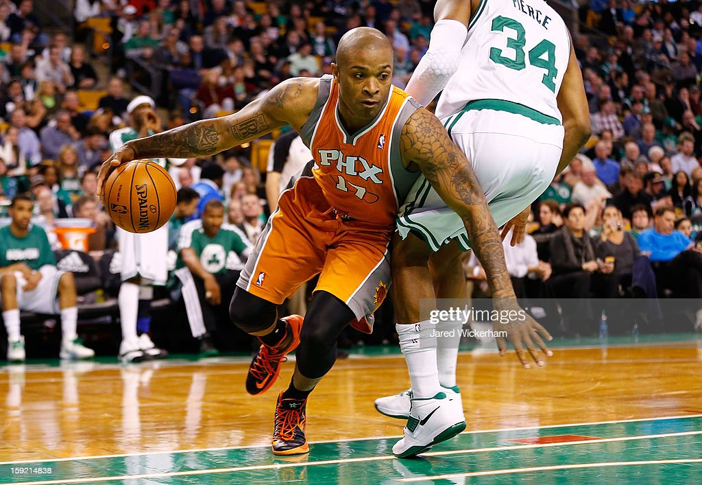 P.J. Tucker #17 of the Phoenix Suns drives around Paul Pierce #34 of the Boston Celtics during the game on January 9, 2013 at TD Garden in Boston, Massachusetts.