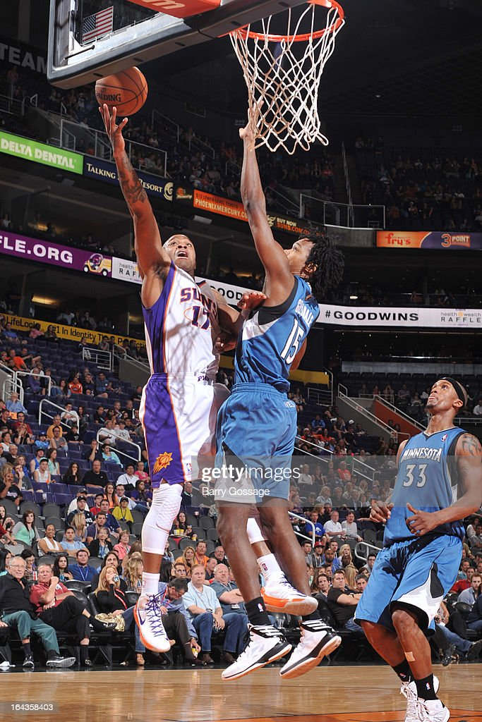 P.J. Tucker #17 of the Phoenix Suns drives for a shot against Mickael Gelabale #15 of the Minnesota Timberwolves on March 22, 2013 at U.S. Airways Center in Phoenix, Arizona.