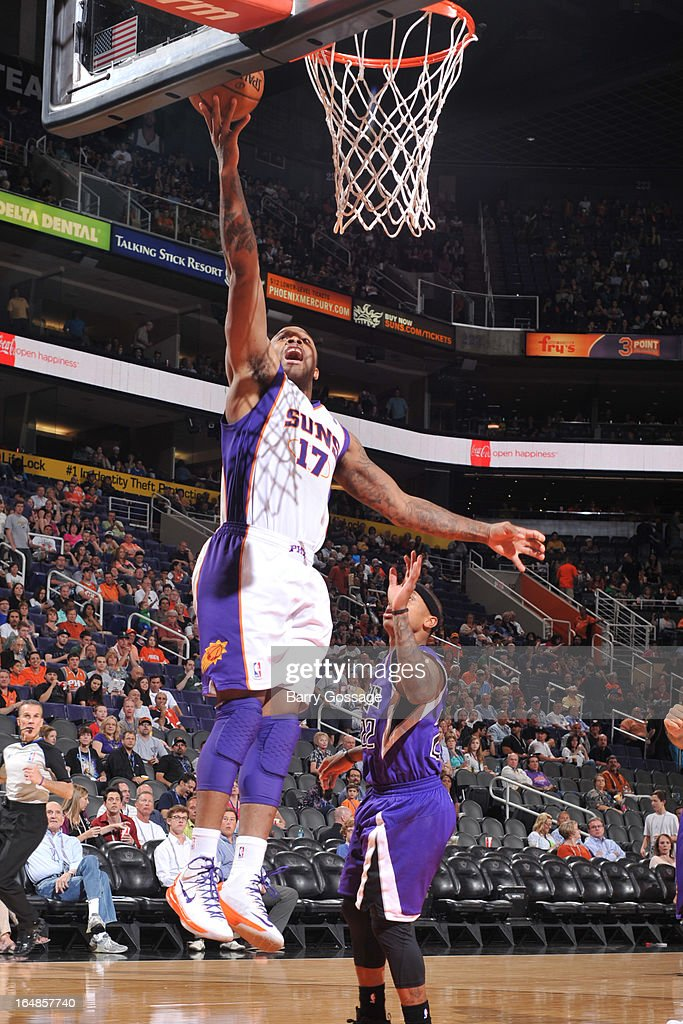 P.J. Tucker #17 of the Phoenix Suns drives for a shot against the Sacramento Kings on March 28, 2013 at U.S. Airways Center in Phoenix, Arizona.