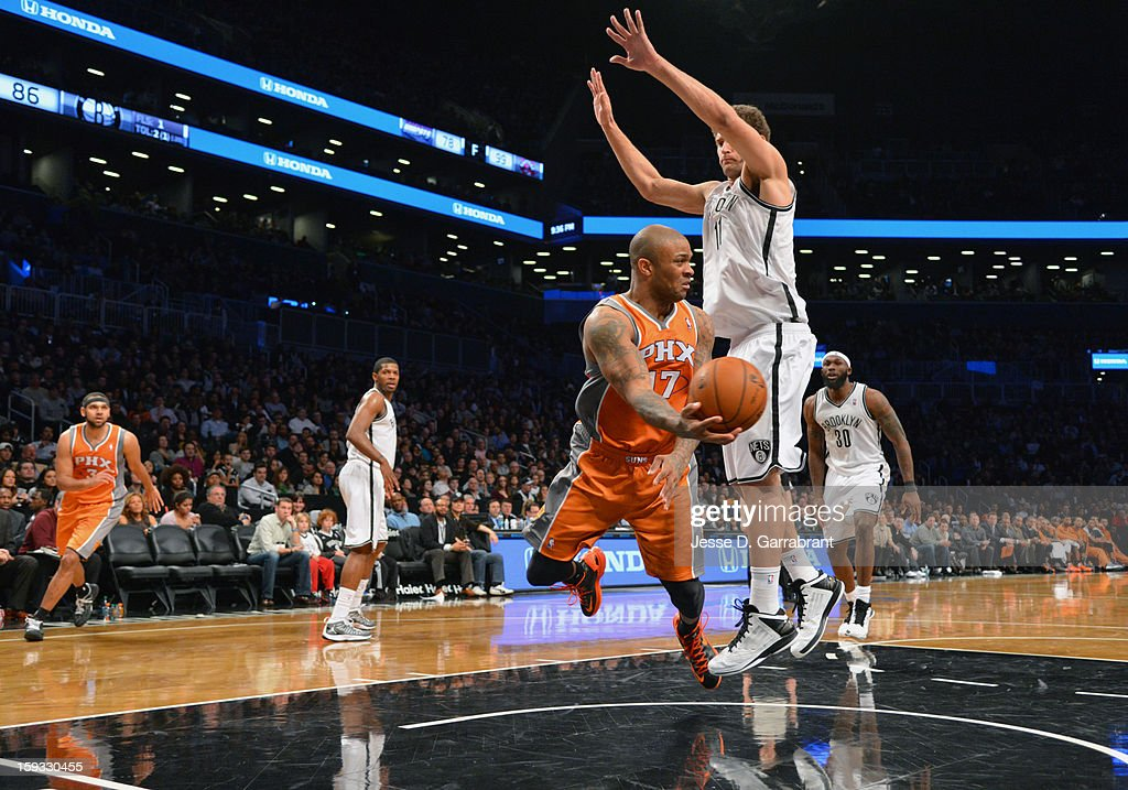 P.J. Tucker #17 of the Phoenix Suns drives to the basket against Brook Lopez #11 of the Brooklyn Nets during the game at the Barclays Center on January 11, 2013 in Brooklyn, New York.