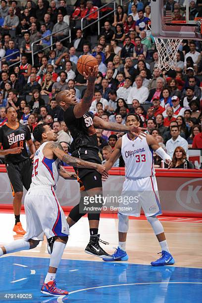 J Tucker of the Phoenix Suns drives to the basket against the Los Angeles Clippers at Staples Center on March 10 2014 in Los Angeles California NOTE...
