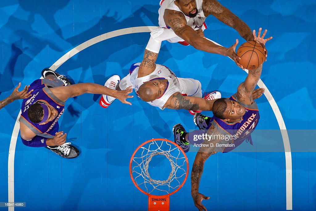 P.J. Tucker #17 of the Phoenix Suns fights for a rebound against Caron Butler #5 and DeAndre Jordan #6 of the Los Angeles Clippers at Staples Center on April 3, 2013 in Los Angeles, California.