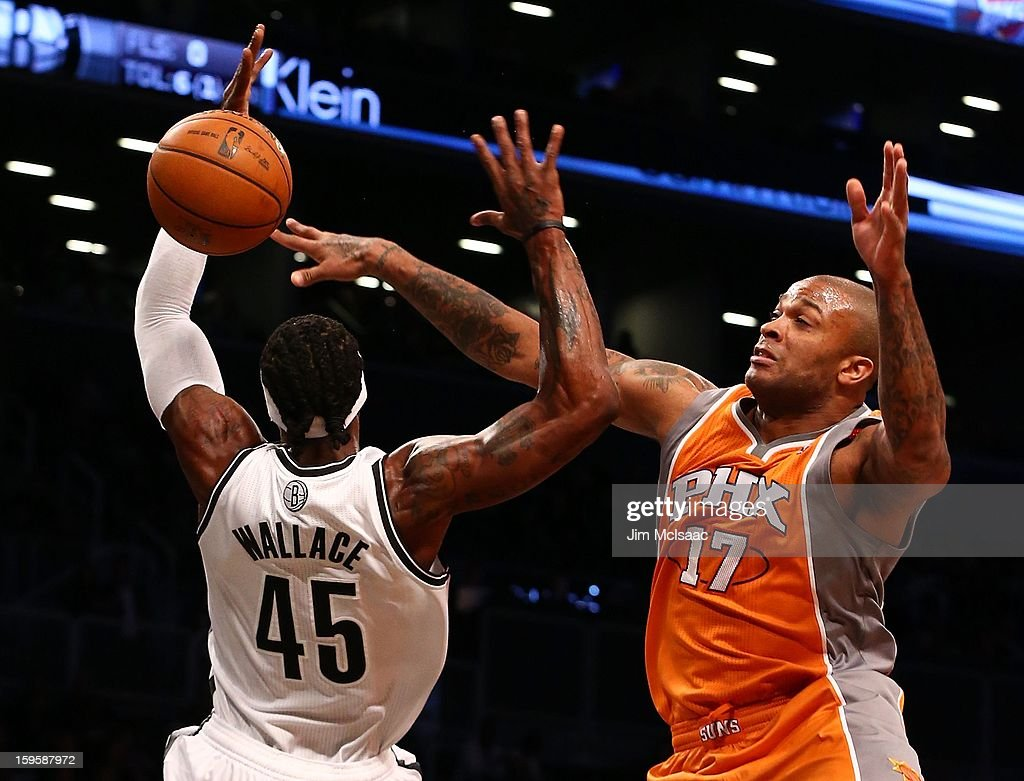 P.J. Tucker #17 of the Phoenix Suns fouls Gerald Wallace #45 of the Brooklyn Nets at Barclays Center on January 11, 2013 in the Brooklyn borough of New York City.The Nets defeated the Suns 99-79.