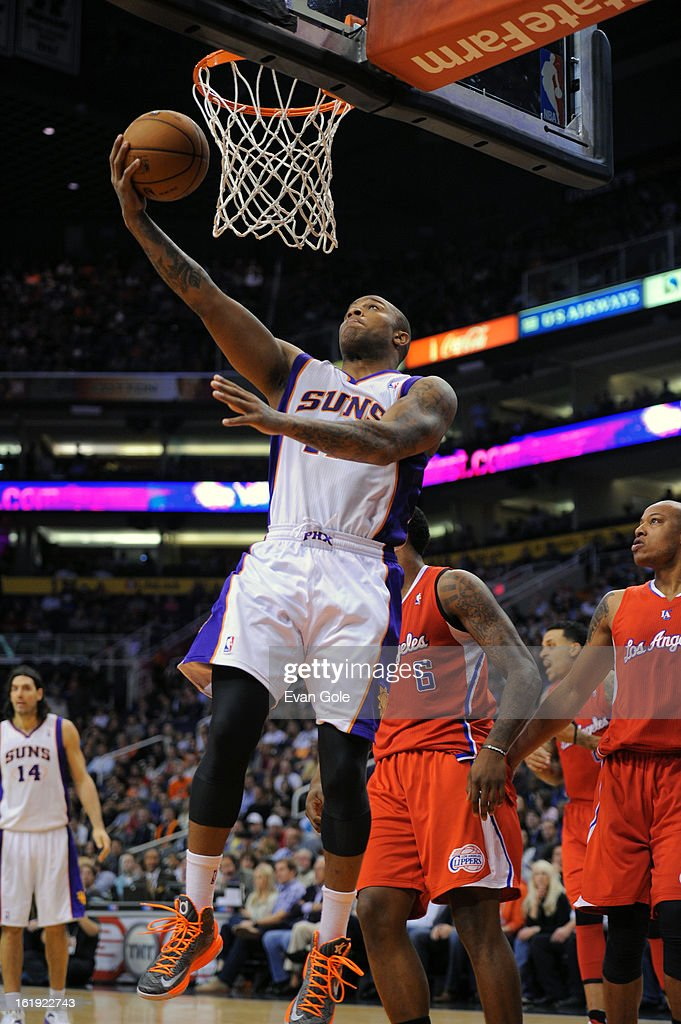 P.J. Tucker #17 of the Phoenix Suns goes in for a reverse layup against the Los Angeles Clippers at US Airways Center on January 24, 2013 in Phoenix, Arizona.