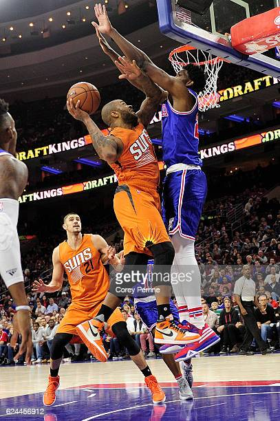 J Tucker of the Phoenix Suns goes up against Joel Embiid of the Philadelphia 76ers during the first quarter at the Wells Fargo Center on November 19...