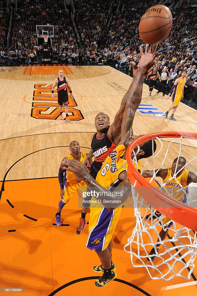 P.J. Tucker #17 of the Phoenix Suns goes up for a rebound against the Los Angeles Lakers at US Airways Center on January 30, 2013 in Phoenix, Arizona.