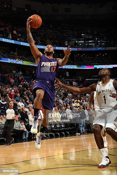 J Tucker of the Phoenix Suns goes up for a shot against the New Orleans Pelicans on April 9 2014 at the Smoothie King Center in New Orleans Louisiana...