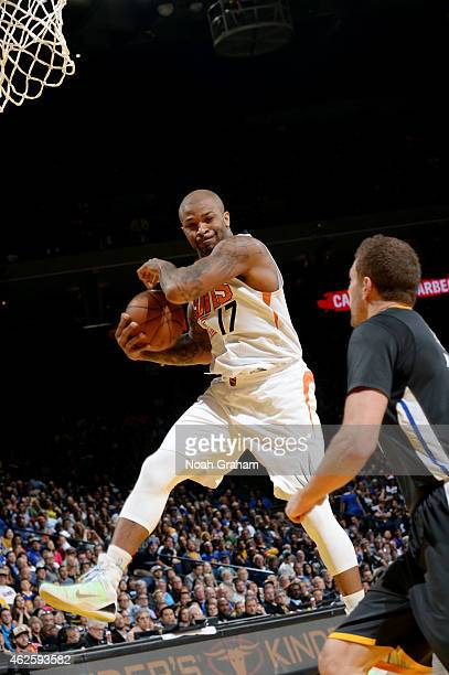 J Tucker of the Phoenix Suns grabs a rebound against the Golden State Warriors on January 31 2015 at Oracle Arena in Oakland California NOTE TO USER...