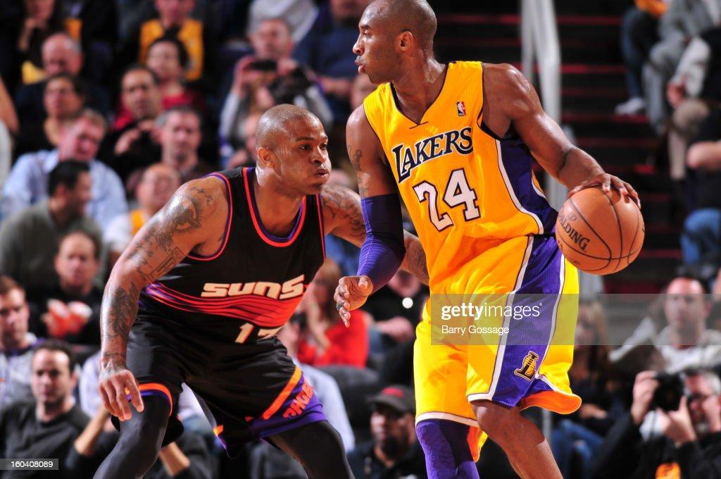 P.J. Tucker #17 of the Phoenix Suns guards Kobe Bryant #24 of the Los Angeles Lakers on January 30, 2013 at U.S. Airways Center in Phoenix, Arizona.