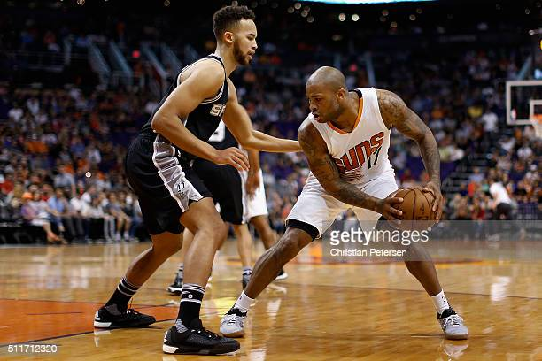 J Tucker of the Phoenix Suns handles the ball against Kyle Anderson of the San Antonio Spurs during the first half of the NBA game at Talking Stick...
