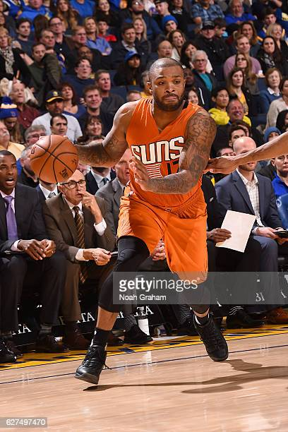 J Tucker of the Phoenix Suns handles the ball against the Golden State Warriors on December 3 2016 at ORACLE Arena in Oakland California NOTE TO USER...