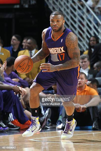 J Tucker of the Phoenix Suns handles the ball against the New Orleans Pelicans during an NBA game on April 09 2014 at the Smoothie King Center in New...