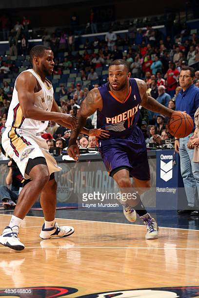 J Tucker of the Phoenix Suns handles the ball against the New Orleans Pelicans on April 9 2014 at the Smoothie King Center in New Orleans Louisiana...