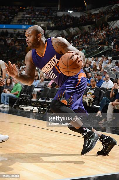 J Tucker of the Phoenix Suns handles the ball against the San Antonio Spurs during a preseason game on October 20 2015 at the ATT Center in San...