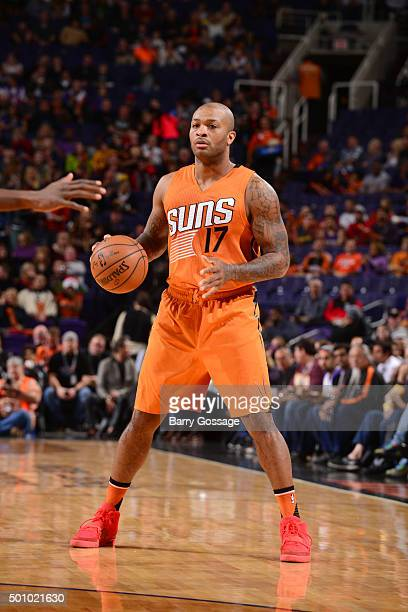 J Tucker of the Phoenix Suns handles the ball during the game against the Portland Trail Blazers on December 11 2015 at US Airways Center in Phoenix...