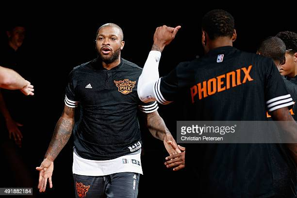 J Tucker of the Phoenix Suns highfives teammates as he is introduced to the preseason NBA game against the Sacramento Kings at Talking Stick Resort...