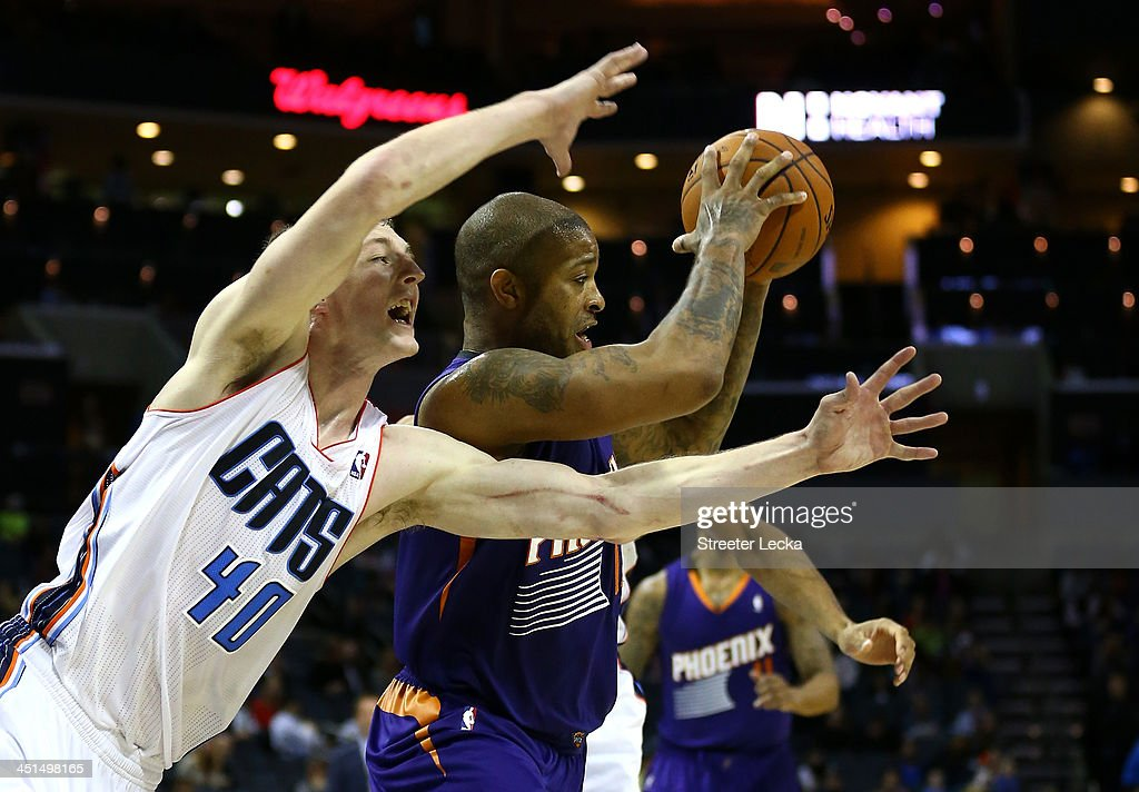 P.J. Tucker #17 of the Phoenix Suns keeps the ball away from Cody Zeller #40 of the Charlotte Bobcats during their game at Time Warner Cable Arena on November 22, 2013 in Charlotte, North Carolina.