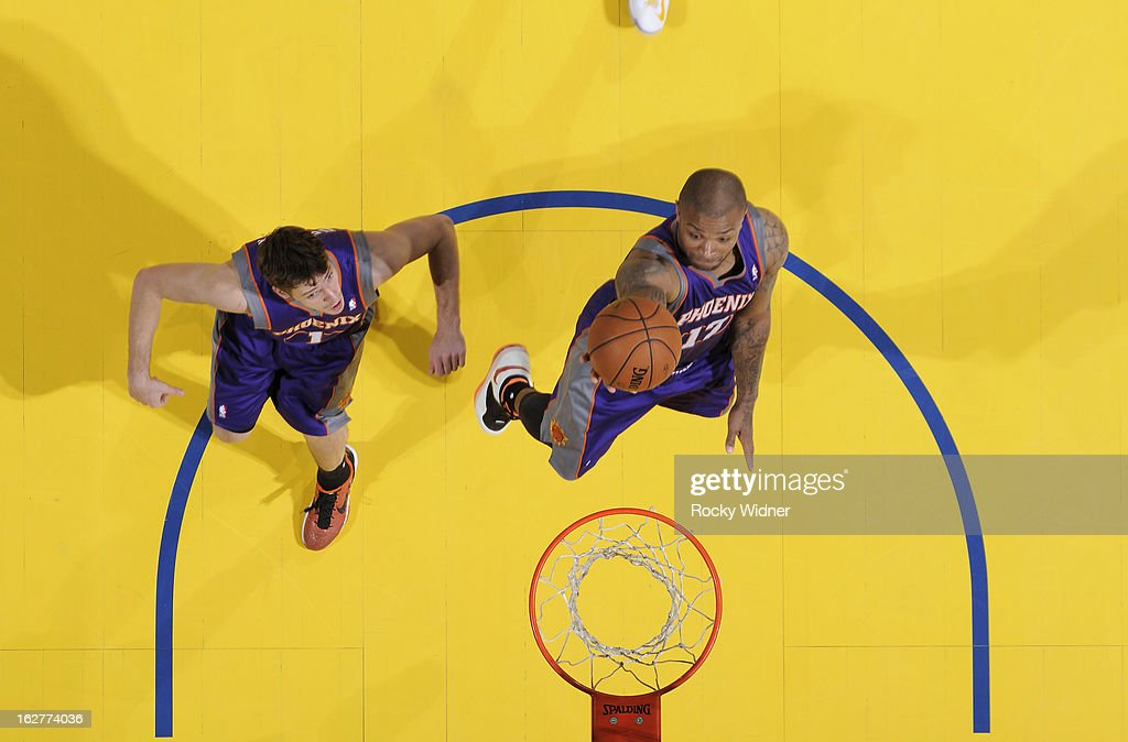 P.J. Tucker #17 of the Phoenix Suns lays the ball up against the Golden State Warriors on February 20, 2013 at Oracle Arena in Oakland, California.