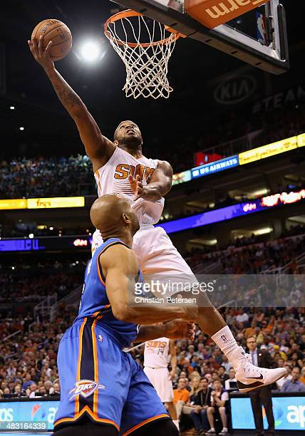 J Tucker of the Phoenix Suns lays up a shot over Derek Fisher of the Oklahoma City Thunder during the second half of the NBA game at US Airways...