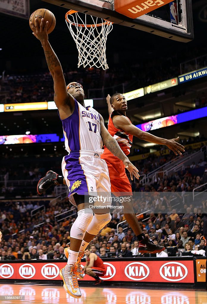 P.J. Tucker #17 of the Phoenix Suns lays up a shot past Ronnie Price #24 of the Portland Trail Blazers during the NBA game at US Airways Center on November 21, 2012 in Phoenix, Arizona. The Suns defeated the Trail Blazers 114-87.