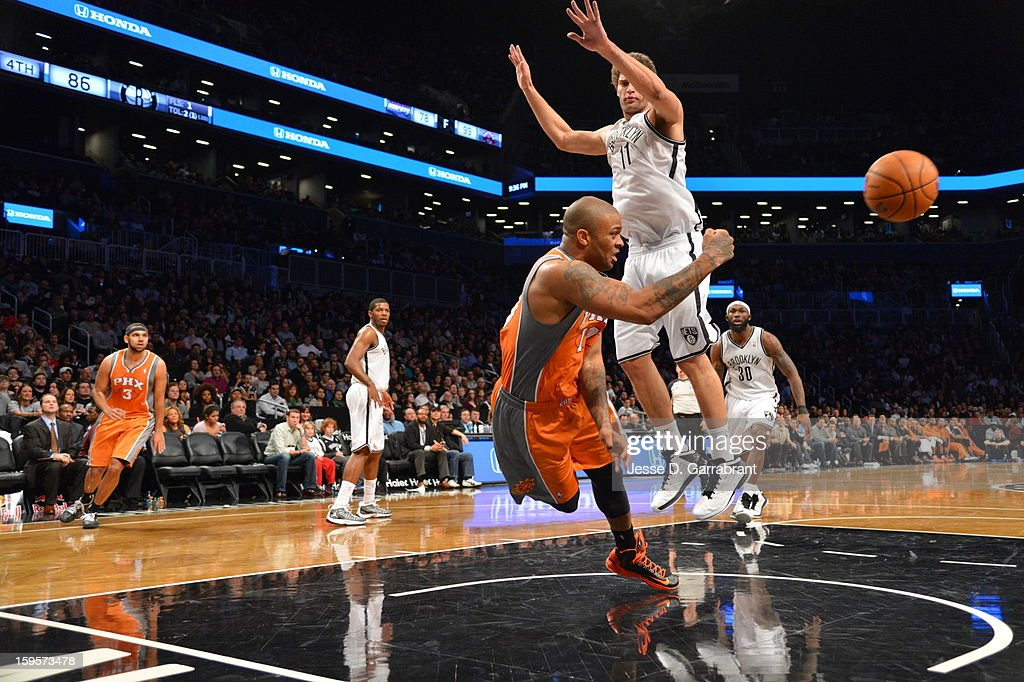 P.J. Tucker #17 of the Phoenix Suns passes the ball against the Brooklyn Nets at the Barclays Center on January 11, 2013 in Brooklyn, New York.