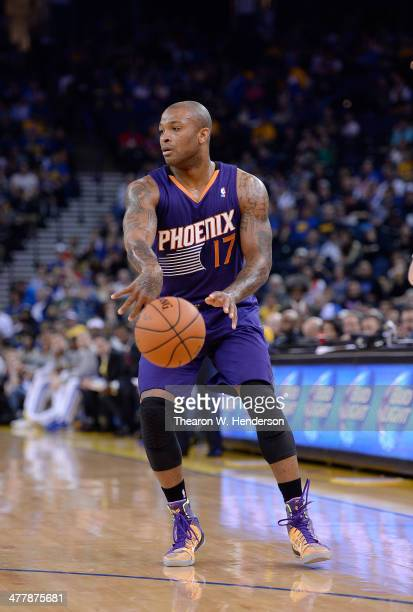 J Tucker of the Phoenix Suns passes the ball against the Golden State Warriors at ORACLE Arena on March 9 2014 in Oakland California NOTE TO USER...