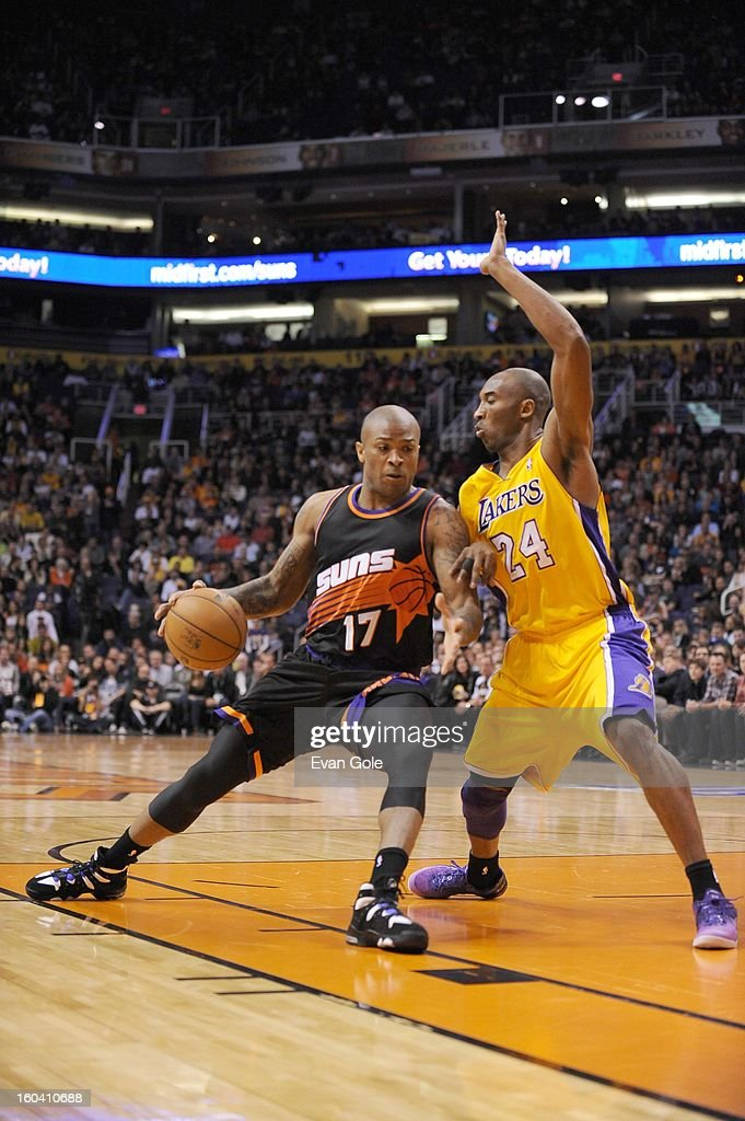 P.J. Tucker #17 of the Phoenix Suns protects the ball from Kobe Bryant #24 of the Los Angeles Lakers during the game between the Los Angeles Lakers and the Phoenix Suns at US Airways Center on January 30, 2013 in Phoenix, Arizona.