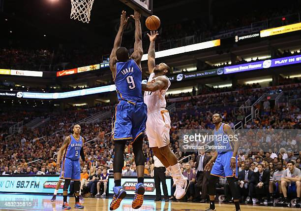 J Tucker of the Phoenix Suns puts up a shot against Serge Ibaka of the Oklahoma City Thunder during the NBA game at US Airways Center on April 6 2014...