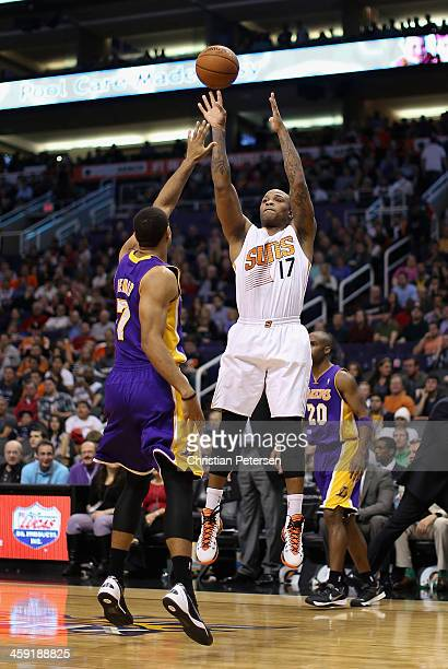 J Tucker of the Phoenix Suns puts up a shot over Xavier Henry of the Los Angeles Lakers during the second half of the NBA game at US Airways Center...