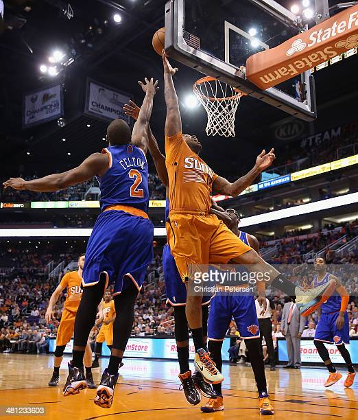 J Tucker of the Phoenix Suns puts up a shot past Raymond Felton of the New York Knicks during the second half of the NBA game at US Airways Center on...