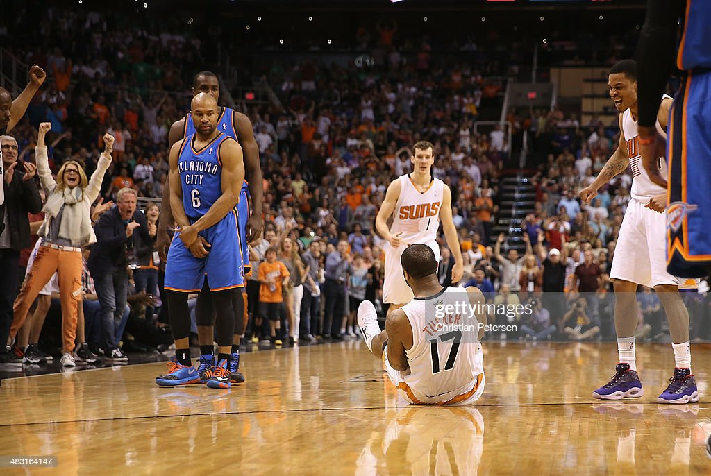P.J. Tucker #17 of the Phoenix Suns reacts after stealing the ball and drawing a foul from Derek Fisher #6 of the Oklahoma City Thunder during the second half of the NBA game at US Airways Center on April 6, 2014 in Phoenix, Arizona. The Suns defeated the Thunder 122-115.