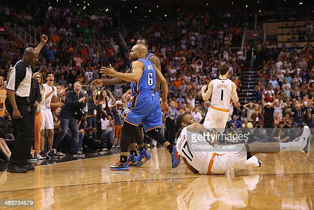 J Tucker of the Phoenix Suns reacts on the court after Tucker stole the ball and drew a foul from Derek Fisher of the Oklahoma City Thunder during...