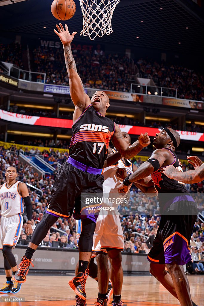 P.J. Tucker #17 of the Phoenix Suns shoots a layup against the Oklahoma City Thunder on February 10, 2013 at U.S. Airways Center in Phoenix, Arizona.