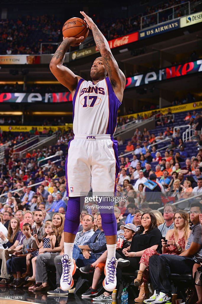 P.J. Tucker #17 of the Phoenix Suns shoots a three-pointer against the Washington Wizards on March 20, 2013 at U.S. Airways Center in Phoenix, Arizona.