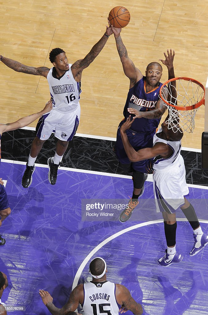 P.J Tucker #17 of the Phoenix Suns shoots against <a gi-track='captionPersonalityLinkClicked' href=/galleries/search?phrase=Ben+McLemore&family=editorial&specificpeople=9966388 ng-click='$event.stopPropagation()'>Ben McLemore</a> #16 and <a gi-track='captionPersonalityLinkClicked' href=/galleries/search?phrase=Travis+Outlaw&family=editorial&specificpeople=203322 ng-click='$event.stopPropagation()'>Travis Outlaw</a> #25 of the Sacramento Kings on October 17, 2013 at Sleep Train Arena in Sacramento, California.