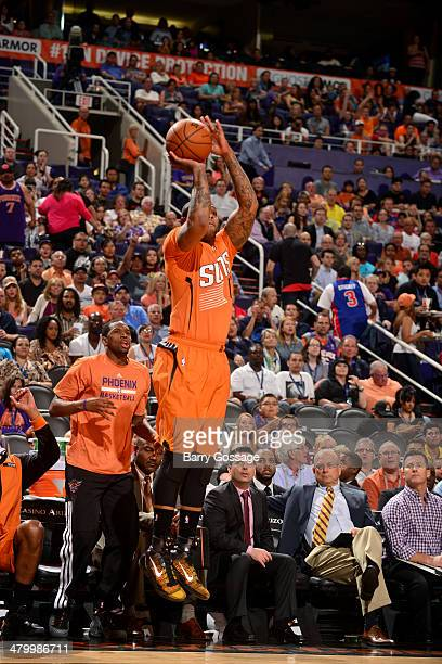 J Tucker of the Phoenix Suns shoots against the Detroit Pistons on March 21 2014 at US Airways Center in Phoenix Arizona NOTE TO USER User expressly...