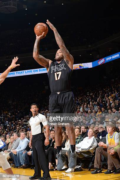 J Tucker of the Phoenix Suns shoots against the Golden State Warriors on December 16 2015 at Oracle Arena in Oakland California NOTE TO USER User...