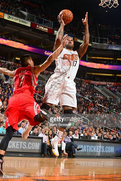 J Tucker of the Phoenix Suns shoots against the Houston Rockets on February 23 2014 at US Airways Center in Phoenix Arizona NOTE TO USER User...