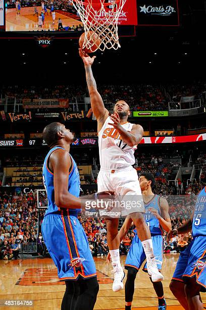 J Tucker of the Phoenix Suns shoots against the Oklahoma City Thunder on April 6 2014 at US Airways Center in Phoenix Arizona NOTE TO USER User...