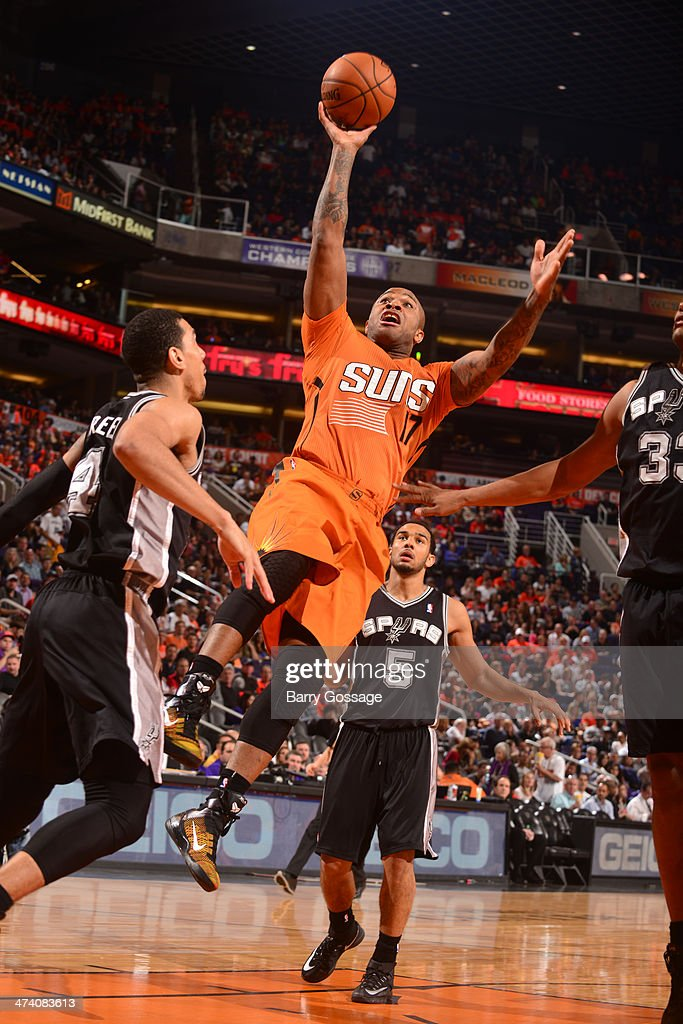 P.J. Tucker #17 of the Phoenix Suns shoots against the San Antonio Spurs on February 21, 2014 at U.S. Airways Center in Phoenix, Arizona.