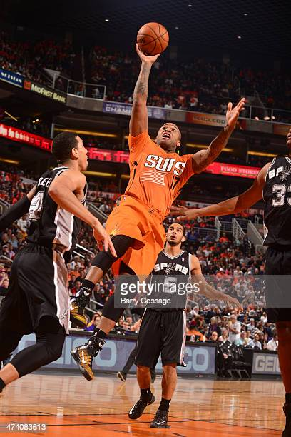J Tucker of the Phoenix Suns shoots against the San Antonio Spurs on February 21 2014 at US Airways Center in Phoenix Arizona NOTE TO USER User...