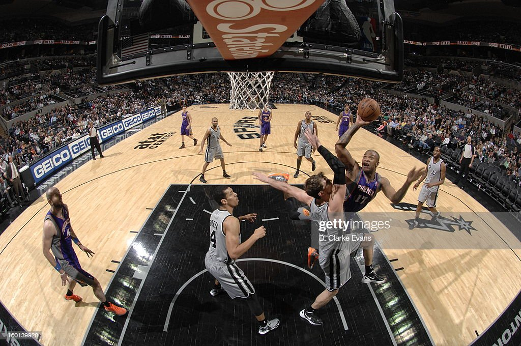 P.J. Tucker #17 of the Phoenix Suns shoots against Tiago Splitter #22 of the San Antonio Spurs on January 26, 2013 at the AT&T Center in San Antonio, Texas.