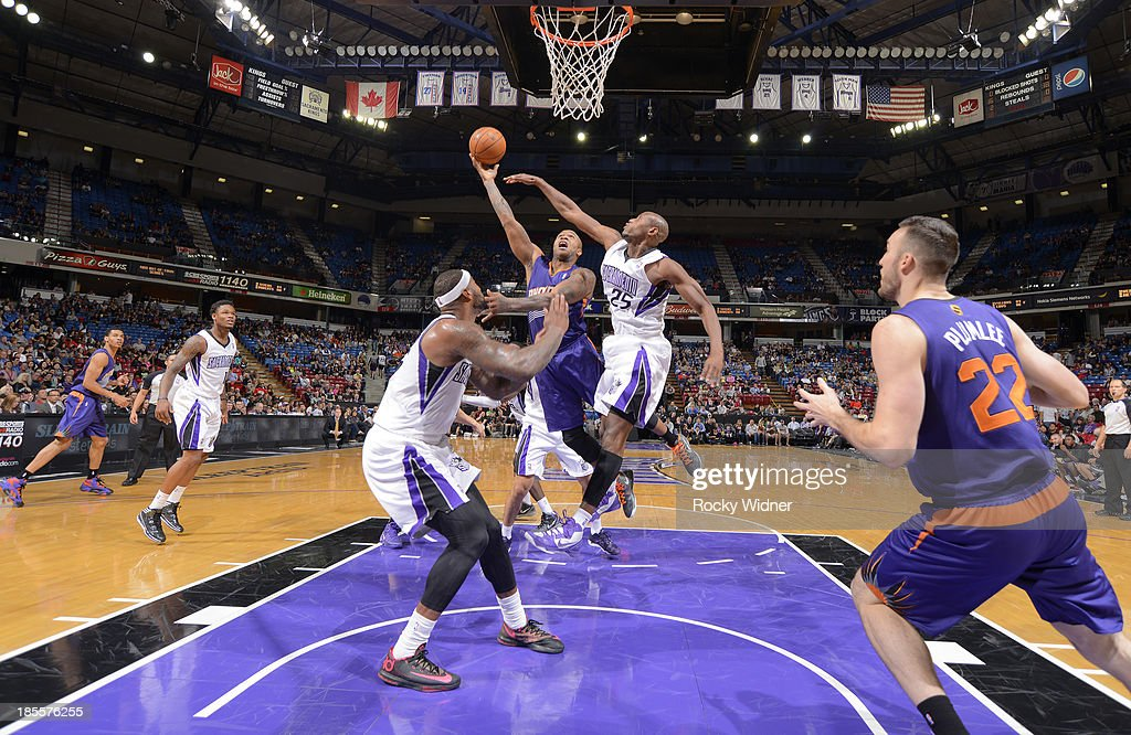 P.J Tucker #17 of the Phoenix Suns shoots against <a gi-track='captionPersonalityLinkClicked' href=/galleries/search?phrase=Travis+Outlaw&family=editorial&specificpeople=203322 ng-click='$event.stopPropagation()'>Travis Outlaw</a> #25 of the Sacramento Kings on October 17, 2013 at Sleep Train Arena in Sacramento, California.