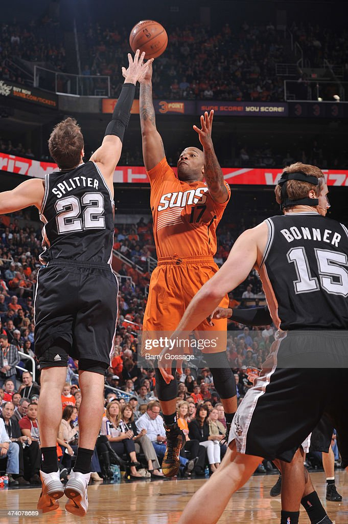 P.J. Tucker #17 of the Phoenix Suns shoots over Tiago Splitter #22 of the San Antonio Spurs on February 21, 2014 at U.S. Airways Center in Phoenix, Arizona.