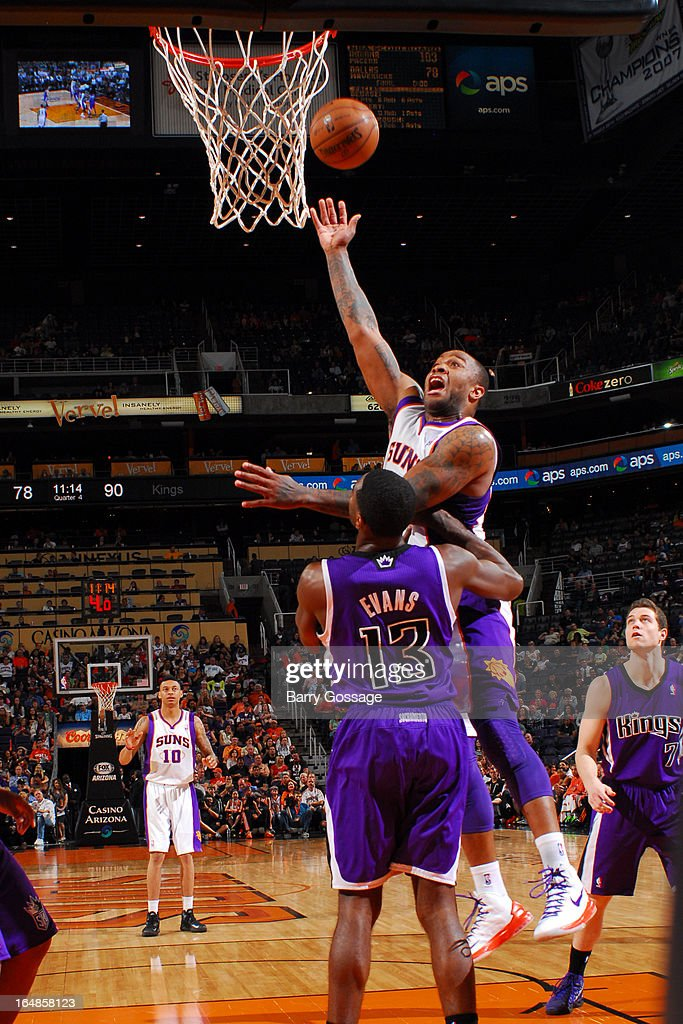 P.J. Tucker #17 of the Phoenix Suns shoots over Tyreke Evans #13 of the Sacramento Kings on March 28, 2013 at U.S. Airways Center in Phoenix, Arizona.