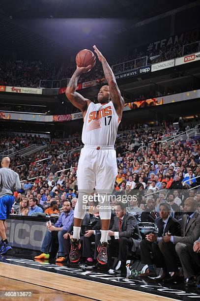 J Tucker of the Phoenix Suns shoots the ball against the Dallas Mavericks during the game on December 23 2014 at US Airways Center in Phoenix Arizona...