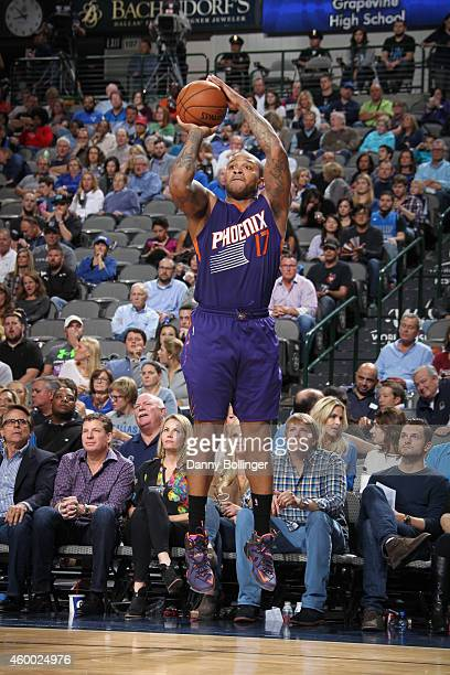 J Tucker of the Phoenix Suns shoots the ball against the Dallas Mavericks on December 5 2014 at the American Airlines Center in Dallas Texas NOTE TO...